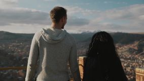 Young touristic couple enjoying mountains view. Tourist traveler on background view mountains. Hiker looking on mountains in trip in Bolivia stock video footage