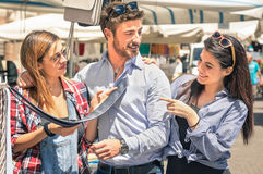 Young tourists best friends shopping in town Stock Photo
