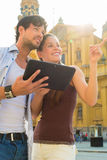 Young Tourists in city with tablet computer Royalty Free Stock Photography