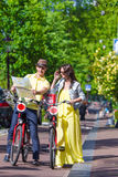 Young tourists couple looking at map with bikes in Stock Photos