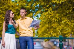 Young tourists couple looking at map in european Royalty Free Stock Photos