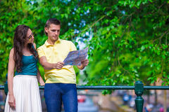Young tourists couple looking at map in european Royalty Free Stock Photo