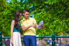 Young tourists couple looking at map in european Royalty Free Stock Photography