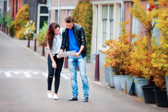 Young tourists couple looking at map in european city Stock Photos