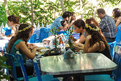 Young tourists enjoy an afternoon snack. SIRINCE, TURKEY - MAY 25, 2014 - Young tourists enjoy an afternoon snack in  covered outdoor seating, Sirince, Turkey Royalty Free Stock Photography