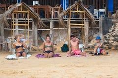 Young tourists enjoying on sandy Hikkaduwa beach Stock Photography