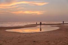 Young tourists enjoying on sandy Hikkaduwa beach Stock Photos