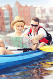 Young tourists with a map in a canoe. A picture of a young couple with a map in a canoe Royalty Free Stock Image