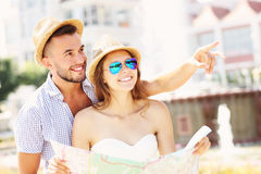 Young tourists with a map Stock Photo