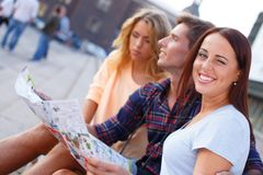 Young tourists with map Royalty Free Stock Images