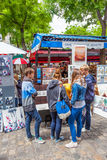 Young Tourists in Montmartre. Young tourists viewing art for sale in Montmartre in Paris Stock Images