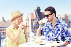 Young tourists relaxing in a cafe Stock Photo