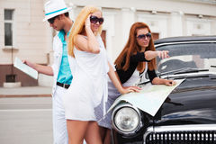 Young tourists with a road map Royalty Free Stock Photos