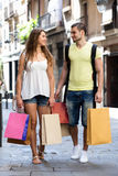 Young tourists in shopping tour. Young couple  hunting after souvenirs in shopping tour Stock Photo