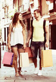 Young tourists in shopping tour. Young couple  hunting after souvenirs in shopping tour Royalty Free Stock Photo