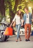 Young tourists in shopping tour. Happy young tourists couple  in shopping tour Stock Photo