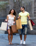 Young tourists in shopping tour. Young tourists hunting after souvenirs in shopping tour Royalty Free Stock Image