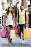 Young tourists in shopping tour. Young men and long-haired women hunting after souvenirs in shopping tour Royalty Free Stock Photo