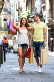 Young tourists in shopping tour Royalty Free Stock Image