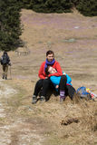 Young tourists sitting on mountain meadow Stock Photography