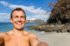 Smiling tourist selfie stock images