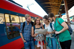 Young tourists travelling by train Stock Images