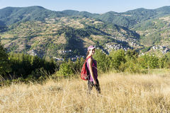 Young tourists woman in the autumn mountain stock image