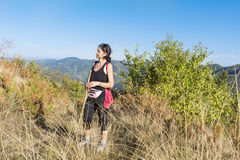 Young tourists woman in the autumn mountain stock photography