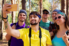Young tourists in the woods Royalty Free Stock Images