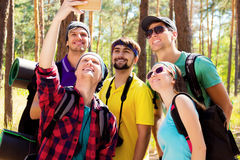 Young tourists in the woods royalty free stock photos