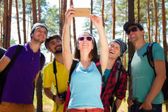 Young tourists in the woods Royalty Free Stock Photo
