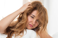 Young tousled woman waking up. Early in the morning Royalty Free Stock Photo