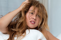 Young tousled woman waking up early Royalty Free Stock Photography