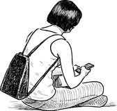 A young towns woman with her smart phone Stock Photos