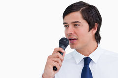Young tradesman with microphone Royalty Free Stock Photo