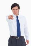 Young tradesman pointing at camera Stock Images