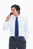Young tradesman talking with microphone Royalty Free Stock Photos