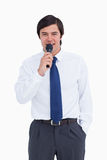 Young tradesman talking with microphone Stock Photography