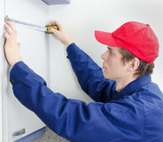 Young tradesman in uniform stock image