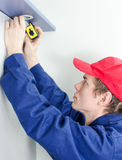 Young tradesman in uniform Stock Photos