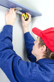 Young tradesman in uniform Stock Photo
