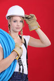 Young tradeswoman. Giving a salute Royalty Free Stock Photography