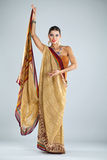 Young traditional Asian Indian woman in indian sari Royalty Free Stock Images
