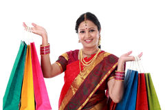 Young traditional Indian woman holding shopping bags Royalty Free Stock Images