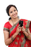 Young traditional Indian woman listening to music Royalty Free Stock Photography
