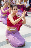 Young traditional Thai dancers performing at Three Kings Monument Chiang Mai stock photo