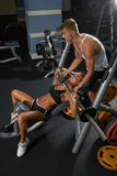 Young training couple in the gym Royalty Free Stock Images