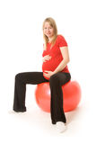 Young training pregnant woman. Isolated on white Stock Images