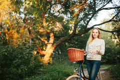 Young Tranquil woman on a Vintage Bicycle Royalty Free Stock Images
