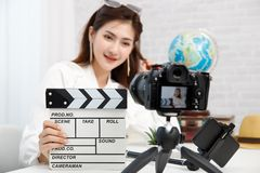 Young travel blogger girl reviewing in front of camera and recording video at home for vlog